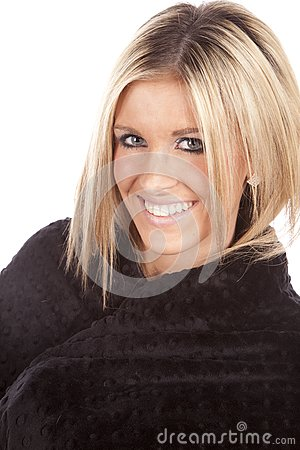 Woman wrapped in blanket smile