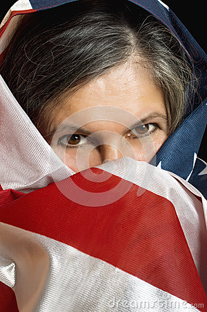 Woman wrapped in a United States flag.