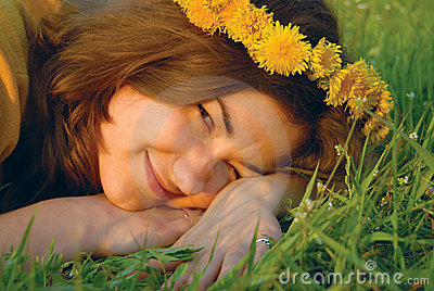 Woman in a wreath from dandelions