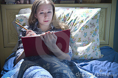 Woman Writing in Bed