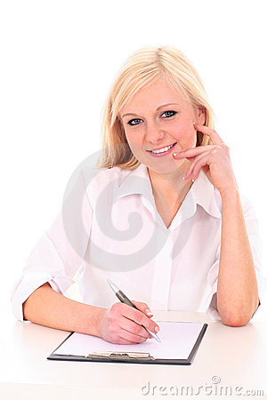 Woman writing on document