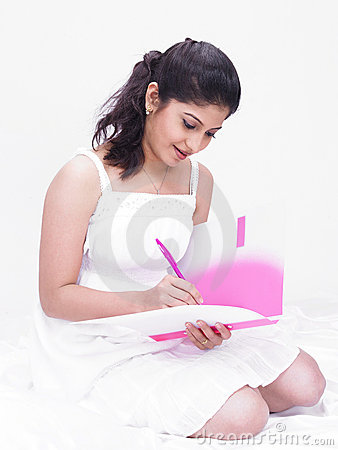 Woman writing in her file