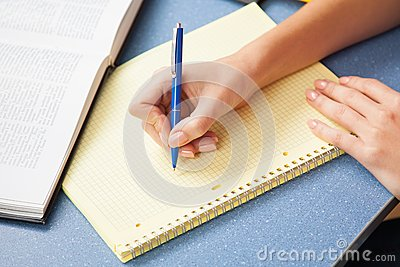 Woman writing in a note pad