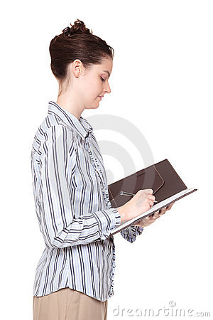 Woman writing in notebook - side view