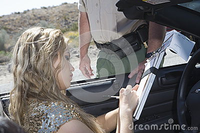 Woman Writing On Traffic Ticket