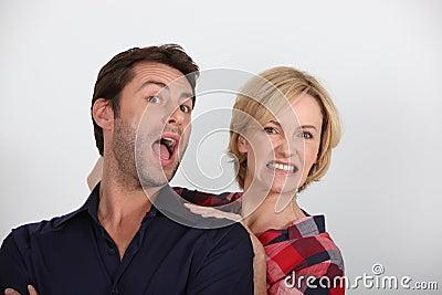 Woman yanking man by head