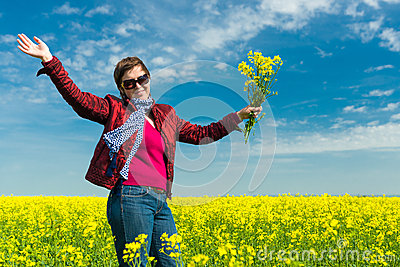 Woman in yellow field of rapeseed Stock Photo