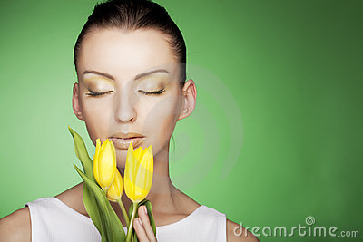 Woman with yellow flowers on green background