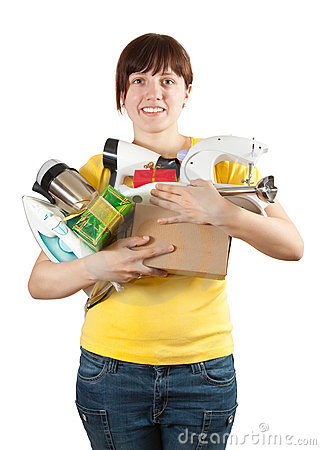 Woman in yellow with household appliances