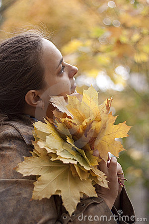 Woman and yellow leaves