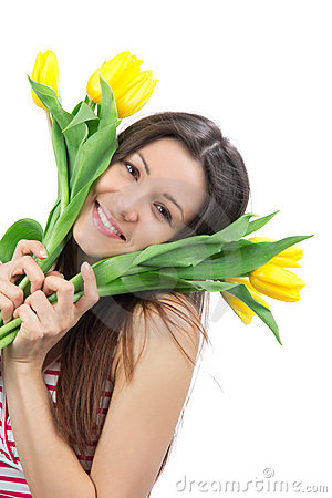 Woman with yellow tulips bouquet of flowers