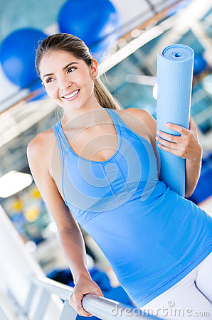 Woman with a yoga mat
