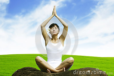 Woman yoga in meadow