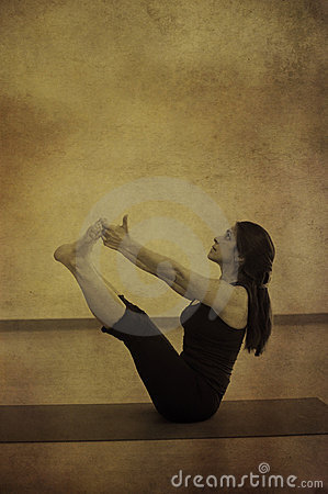 Woman in Yoga Navasana