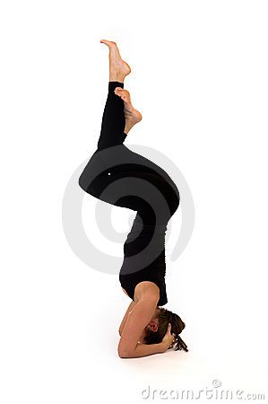 Woman in yoga pose on white