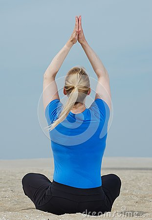 Woman in yoga position from behind