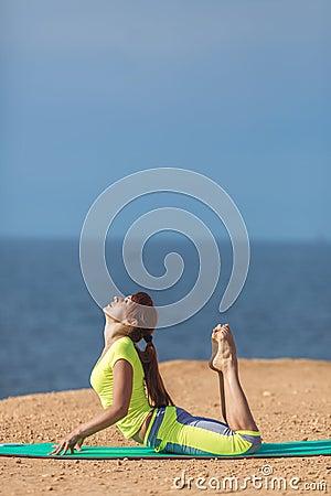 Free Woman Yoga. Series. Outdoor. On The Seashore Stock Photos - 37486413