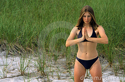 Woman In Yoga Stance Wearing Bikini