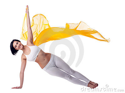 Woman yoga stand on hand and yellow flying fabric