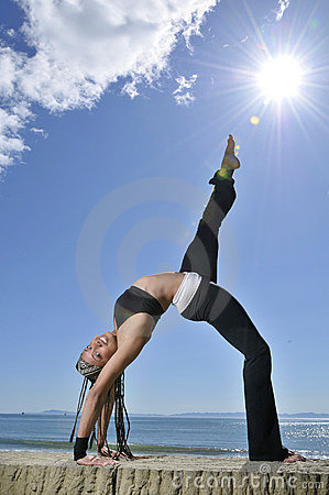 Woman in yoga stretch on beach