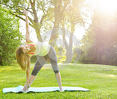 Woman in yoga triangle pose
