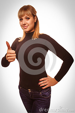 Woman young girl shows positive sign thumbs yes,