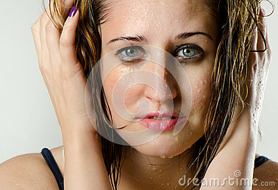 Womans face with water drops