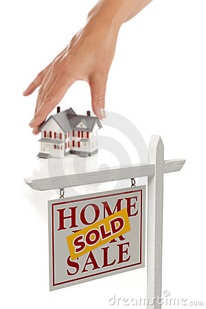 Womans Hand Choosing Home, Sold Real Estate Sign