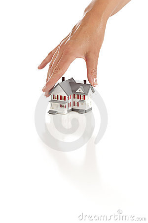 Womans Hand Choosing A Home on White