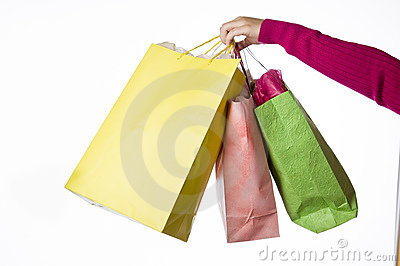 Womans hand extended holding shopping bags