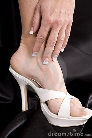 Womans hand on side of foot