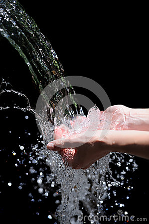 Womans hands with water splash