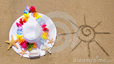 Womans white hat on the sandy beach