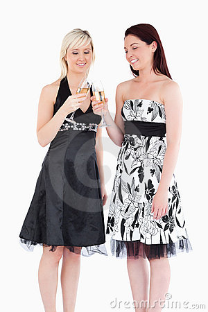 Women in beautiful dresses toasting with champaign