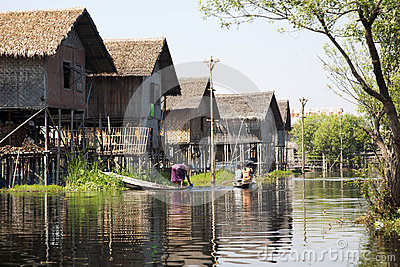 Woman in a Stilted Village on Lake Editorial Stock Photo