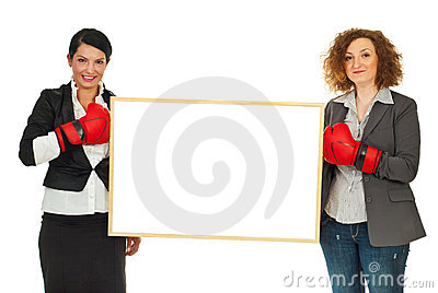 Women with boxing gloves and banner