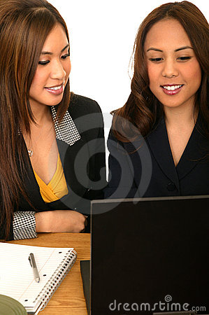 Women Business Team Looking At Laptop