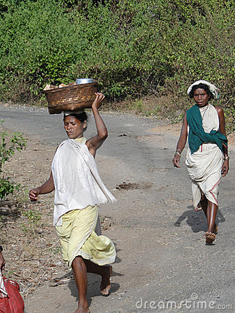 Women carry goods on their heads Editorial Photo