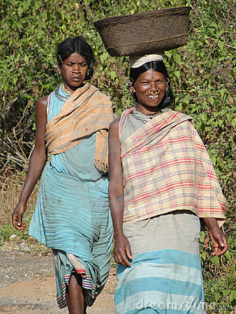 Women carry goods on their heads Editorial Stock Image