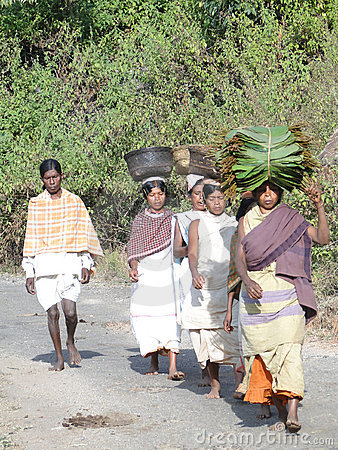 Women carry goods on their heads Editorial Stock Photo