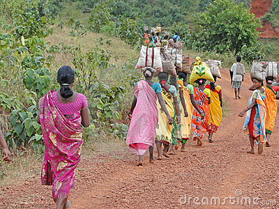 Women carry goods on their heads Editorial Image