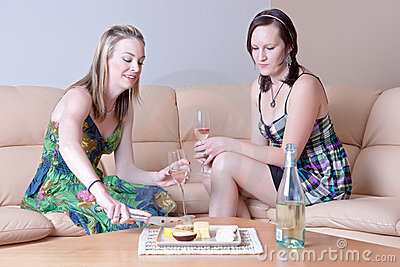 Women chatting over cheese and wine