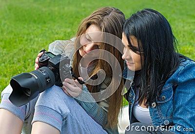 Women checking viewfinder of camera