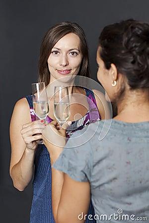 Women clinks glasses