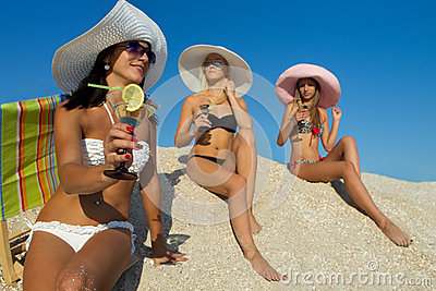 Women with cocktail on beach