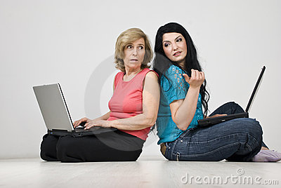 Women conversation and using laptops