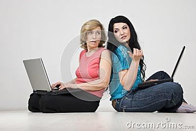 Women conversation and using laptops