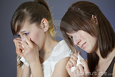 Women crying by watching TV