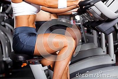 Women cycling in gym