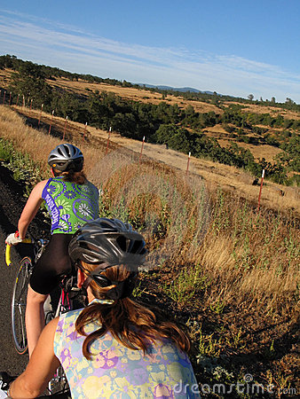 Free Women Cyclists In Hills Stock Image - 3124001